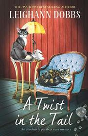 A Twist in the Tail: An absolutely purrfect cozy mystery (The Oyster Cove Guesthouse)