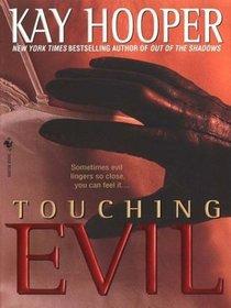 Touching Evil (Thorndike Press Large Print Americana Series)