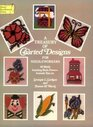 A Treasury of Charted Designs for Needleworkers: 141 Motifs Including Birds, Flowers, Animals, Toys, Etc. (Dover Needlework)